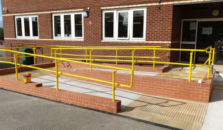 yellow DDA handrail for a school