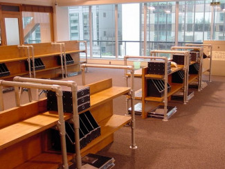 Industrial office design: Tables, shelving, screens and rails