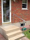 An adjustable angle handrail kit installed on stairs