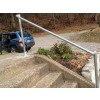 Floor mounted handrail with rounded ends, example