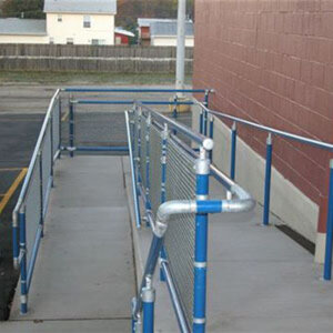 DDA handrail: Blue powder-coated tube with non-powder-coated fittings