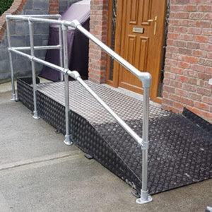 Double sided access handrail installed on a shallow ramp