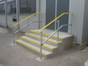 Accessibility railing system installed on both sides of the stairs