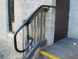 Black powder-coated handrail for stairs