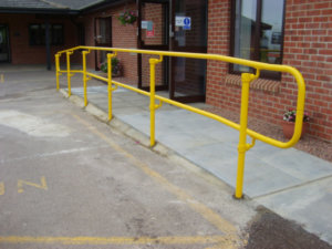 Yellow handrail system installed in front of a surgery