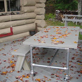 A concrete top table built using the Rugged frame