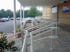 White DDA handrail for a sports venue