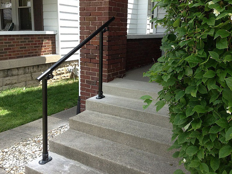 black handrail outside the house