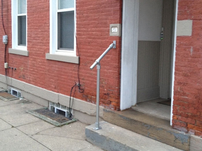 metal handrail kit that fixes onto wall and floor