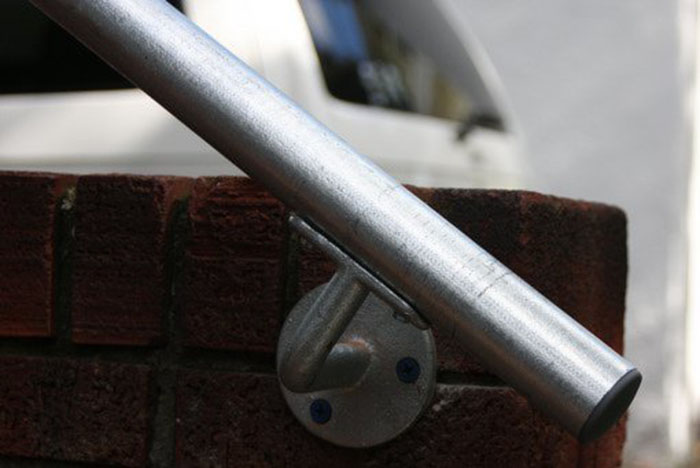 outdoor handrail mounted onto brick