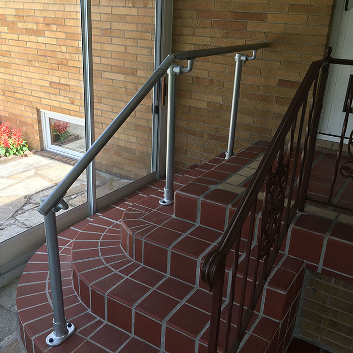 stairs to landing continuous steel rail