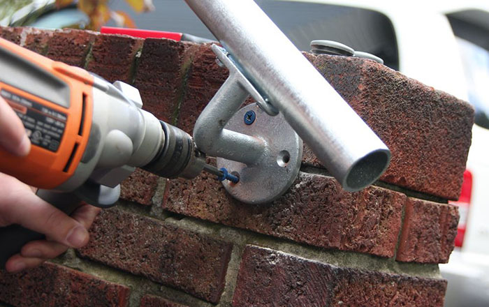 outdoor handrail mounted on a wall
