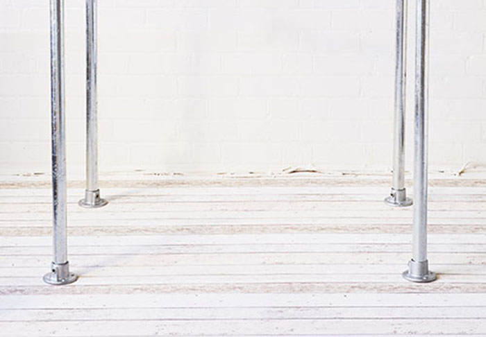 four galvanised steel tube table legs